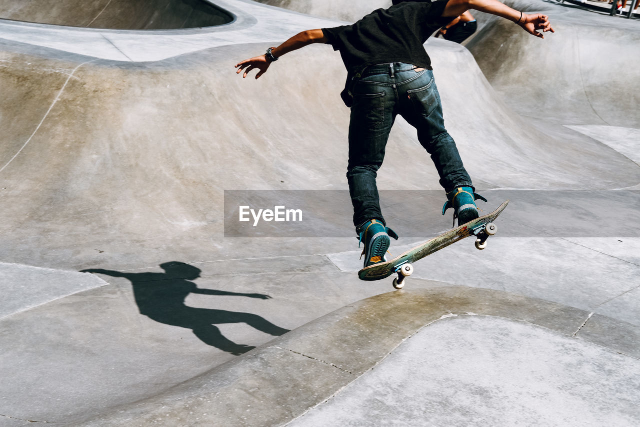 Man Skateboarding At Park