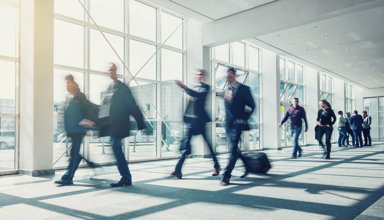 People Walking In Modern Office