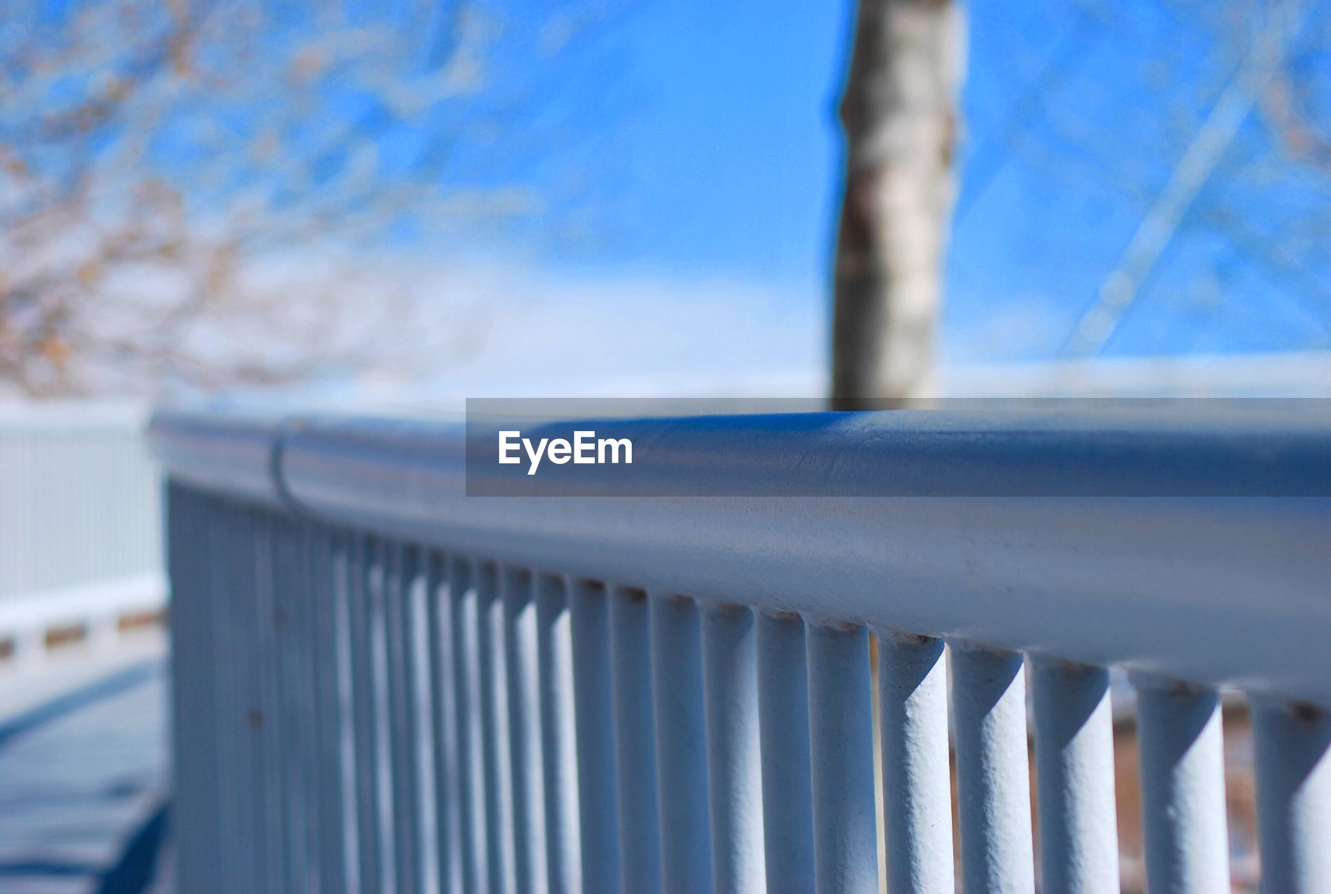 Close-up of railings against blurred sky