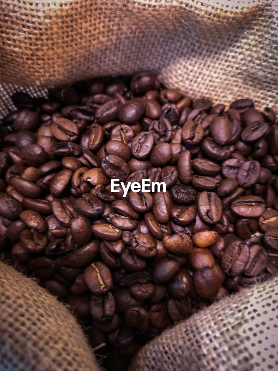roasted coffee bean, food and drink, coffee - drink, brown, coffee, food, indoors, sack, still life, freshness, no people, close-up, coffee bean, caffeine, large group of objects, pattern, jute, container, abundance, drink