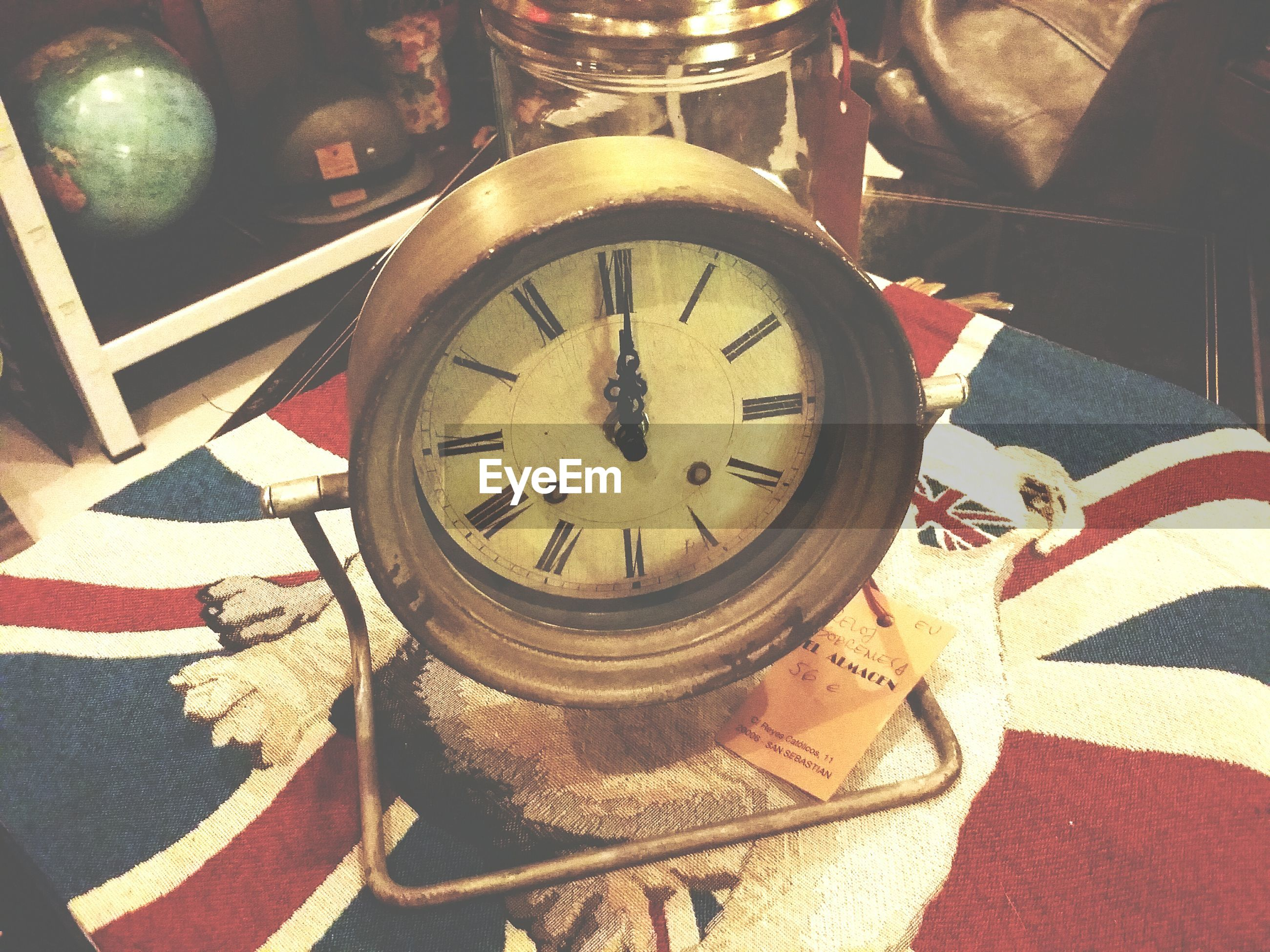 time, clock, indoors, transportation, clock face, number, mode of transport, wheel, old-fashioned, accuracy, close-up, circle, land vehicle, minute hand, retro styled, instrument of time, no people, day, roman numeral, wall clock