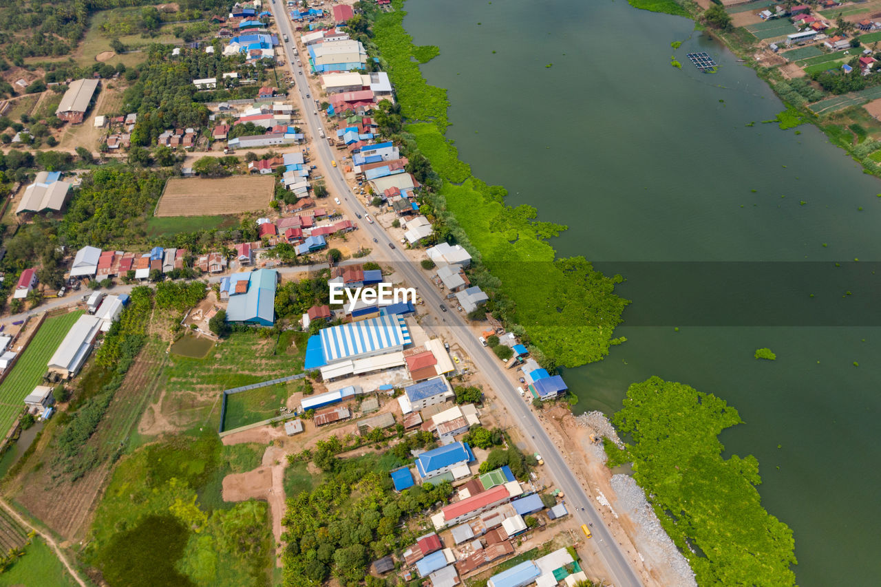 water, architecture, high angle view, building exterior, built structure, plant, day, building, nature, city, tree, no people, outdoors, environment, river, residential district, scenics - nature, aerial view, green color