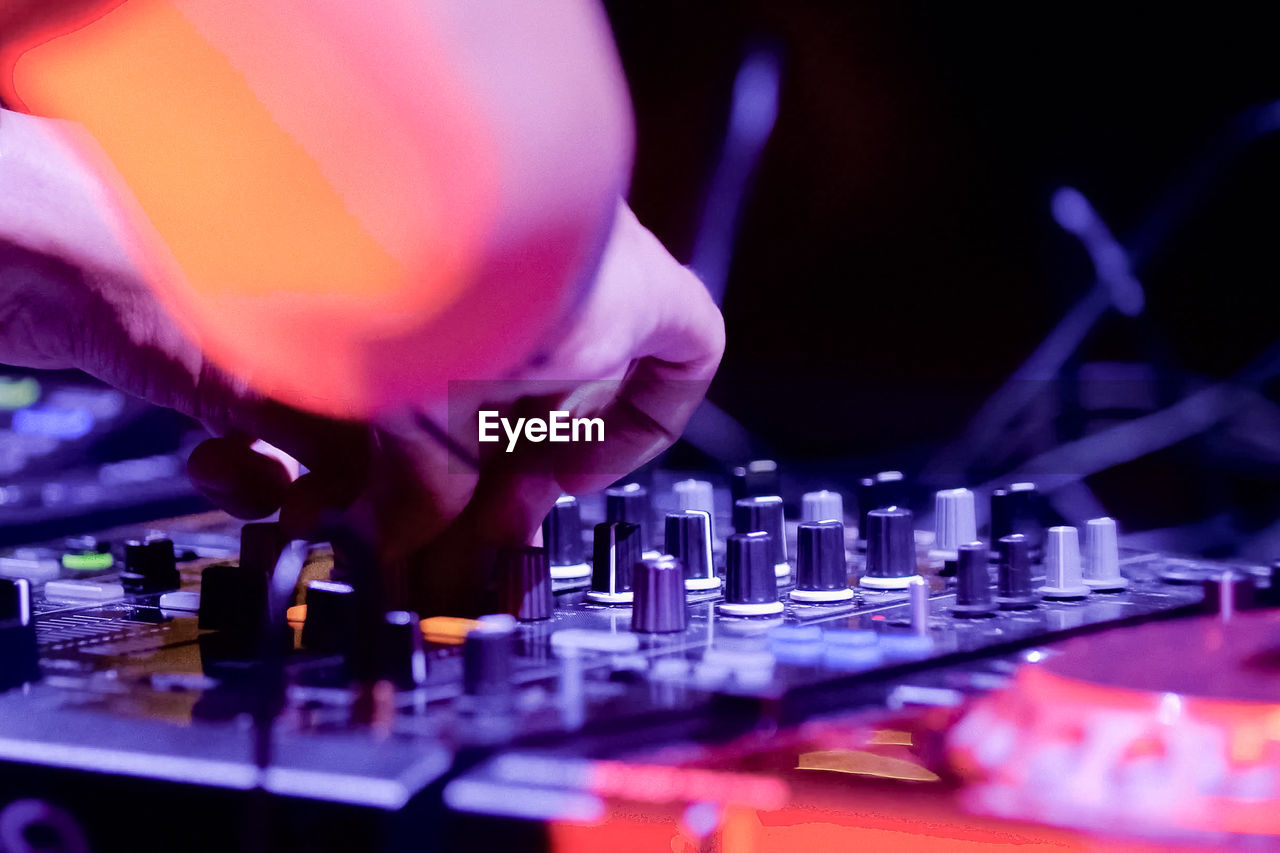 Cropped Hand Of Male Dj Playing Music At Nightclub