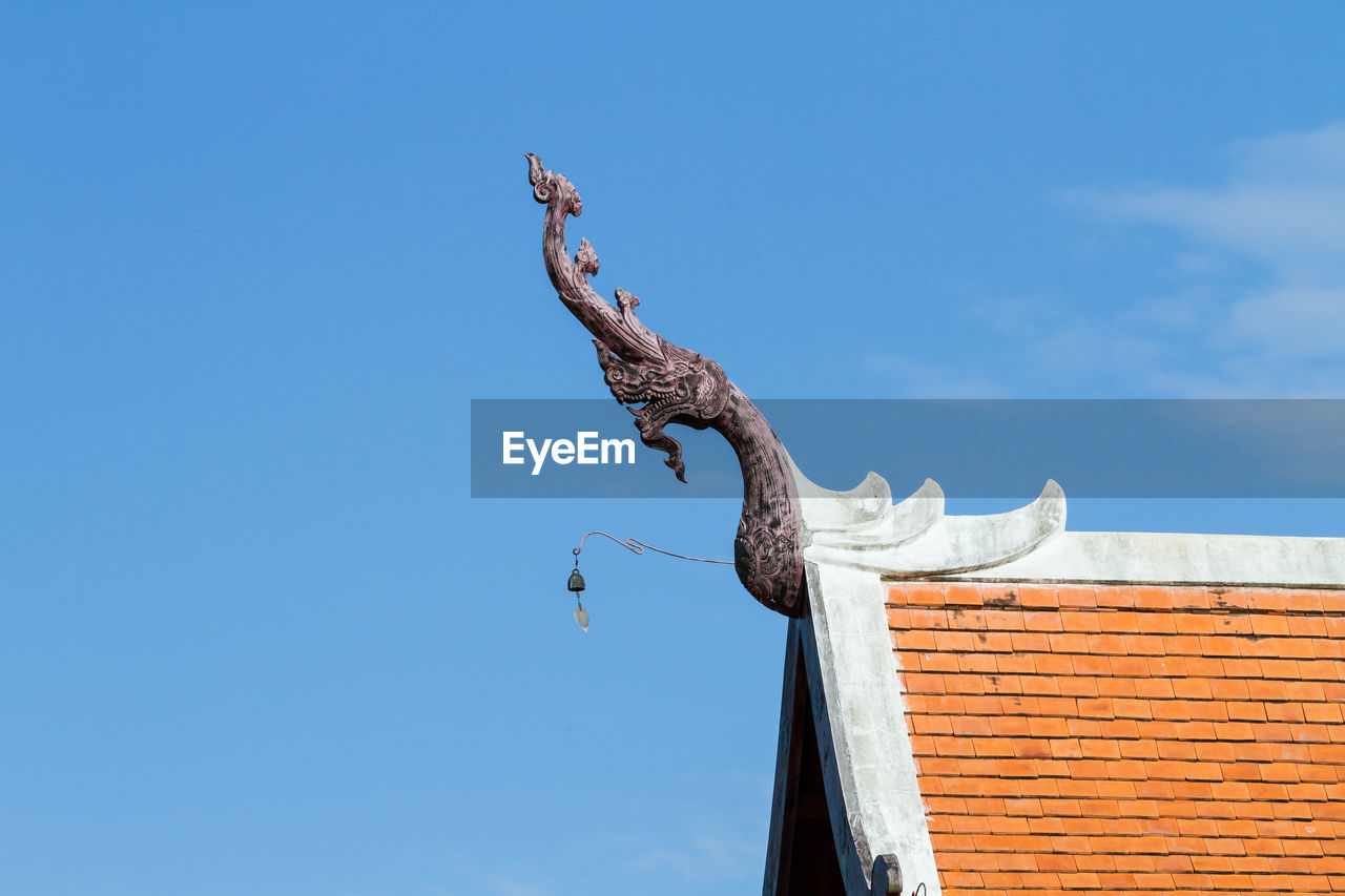 Low Angle View Of Dragon Sculpture On Roof Against Sky At Royal Flora Ratchaphruek