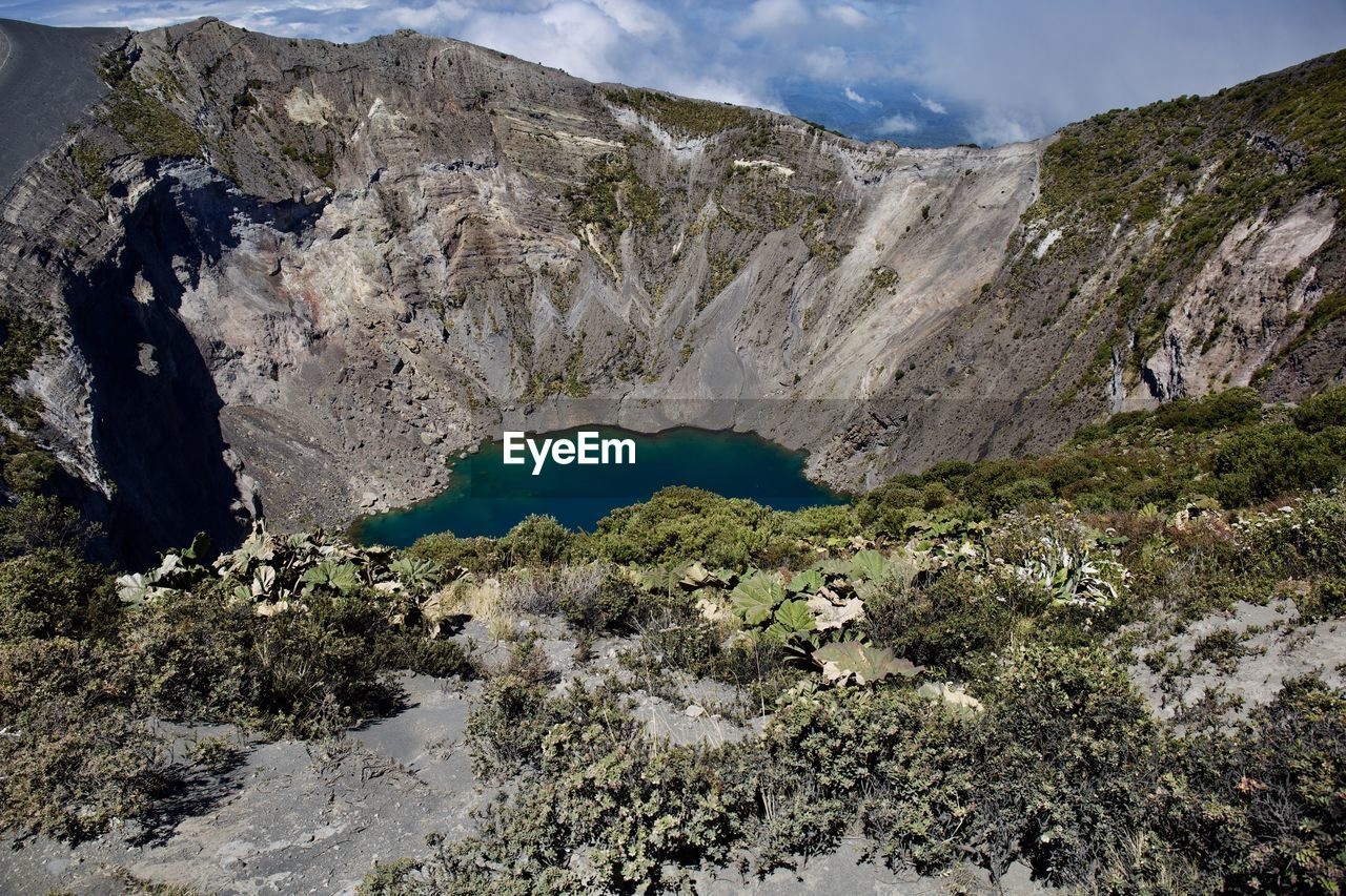 mountain, beauty in nature, scenics - nature, non-urban scene, tranquil scene, nature, tranquility, water, physical geography, geology, day, no people, rock, mountain range, lake, sky, landscape, environment, idyllic, outdoors, formation, volcanic crater, power in nature