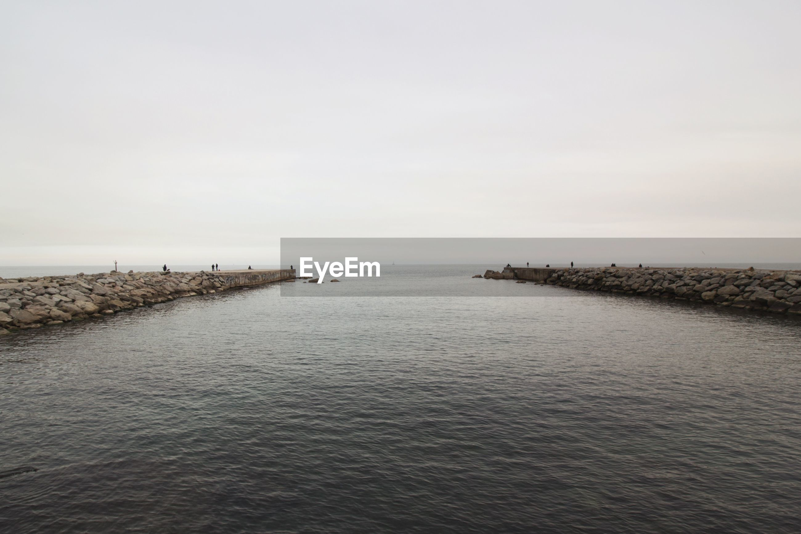 View of tourist on jetty in sea