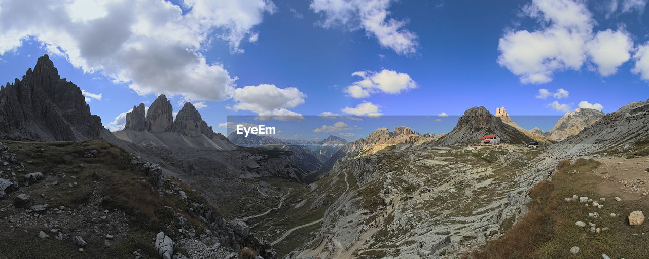 mountain, sky, cloud - sky, scenics - nature, landscape, beauty in nature, mountain range, environment, nature, rock, non-urban scene, tranquil scene, panoramic, remote, tranquility, rock - object, no people, geology, physical geography, idyllic, formation, mountain peak, arid climate