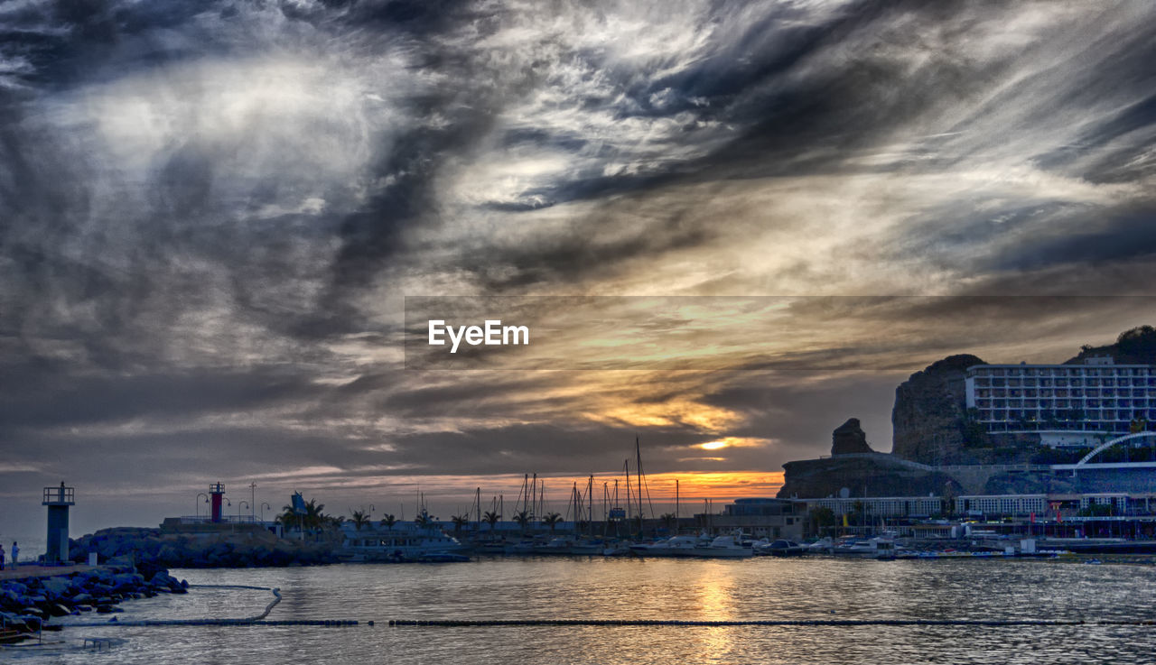 sky, architecture, cloud - sky, building exterior, built structure, water, waterfront, sunset, city, cityscape, river, no people, skyscraper, outdoors, travel destinations, nature, scenics, nautical vessel, urban skyline, beauty in nature, storm cloud, day, city location