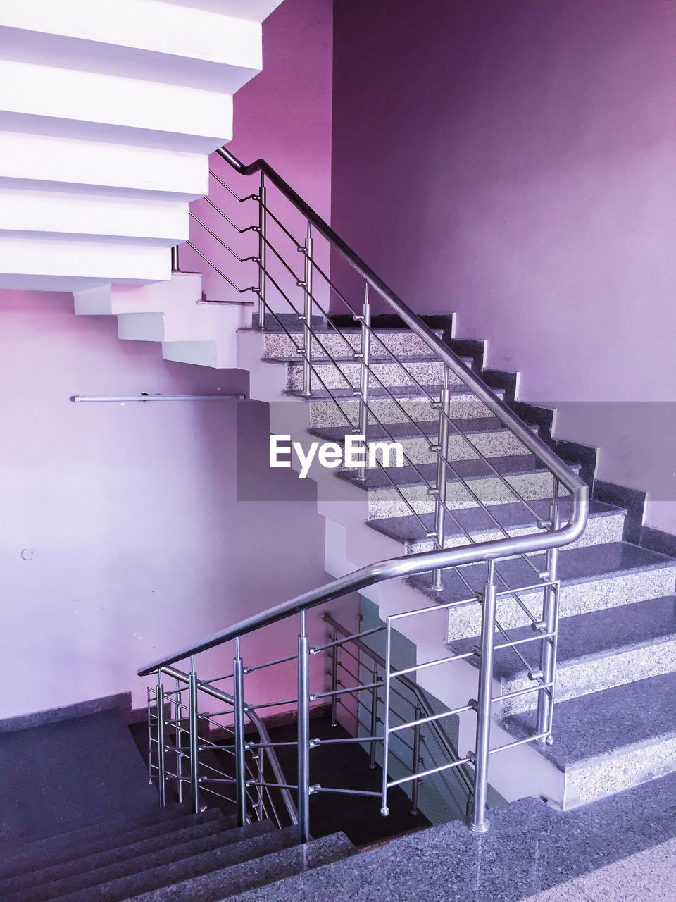 staircase, architecture, steps and staircases, built structure, railing, building exterior, no people, spiral, pink color, day, purple, building, absence, spiral staircase, low angle view, moving up, outdoors