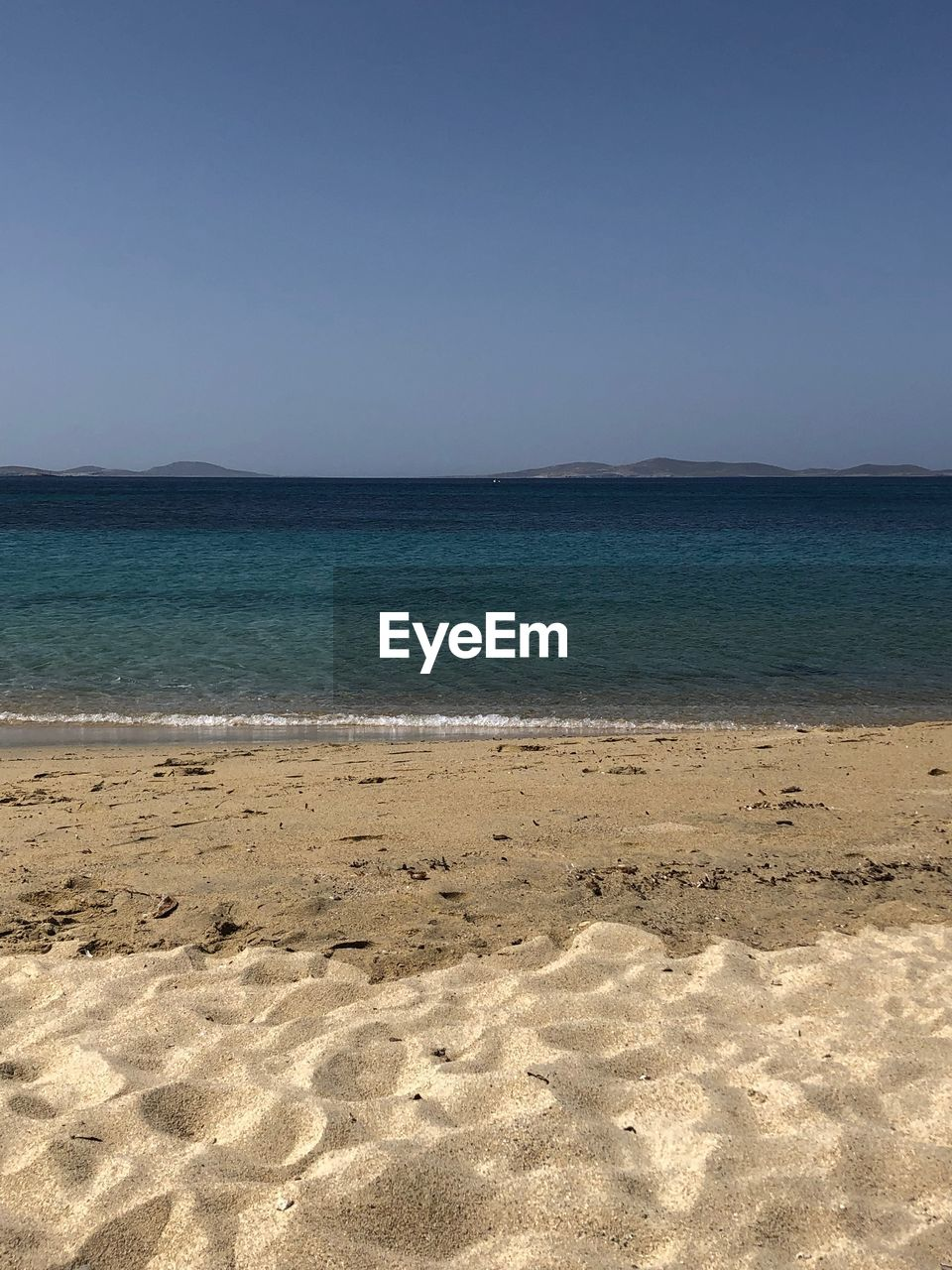 land, sea, beach, tranquility, sky, beauty in nature, scenics - nature, water, tranquil scene, sand, clear sky, nature, horizon, no people, horizon over water, blue, idyllic, day, non-urban scene, outdoors, purity