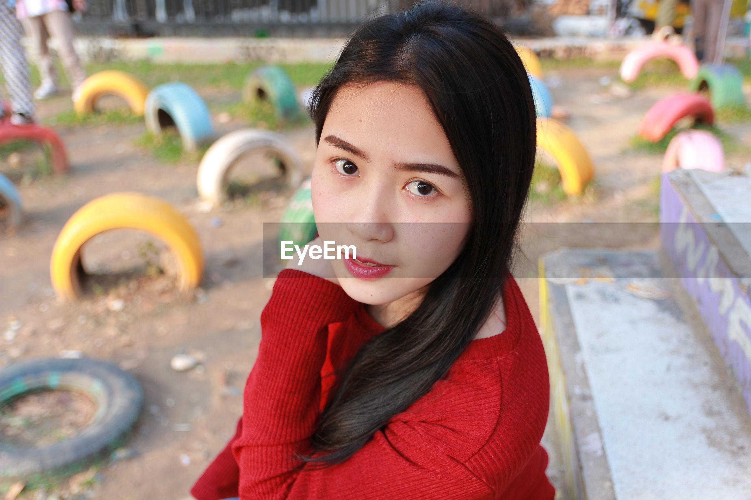 Portrait of woman sitting at park