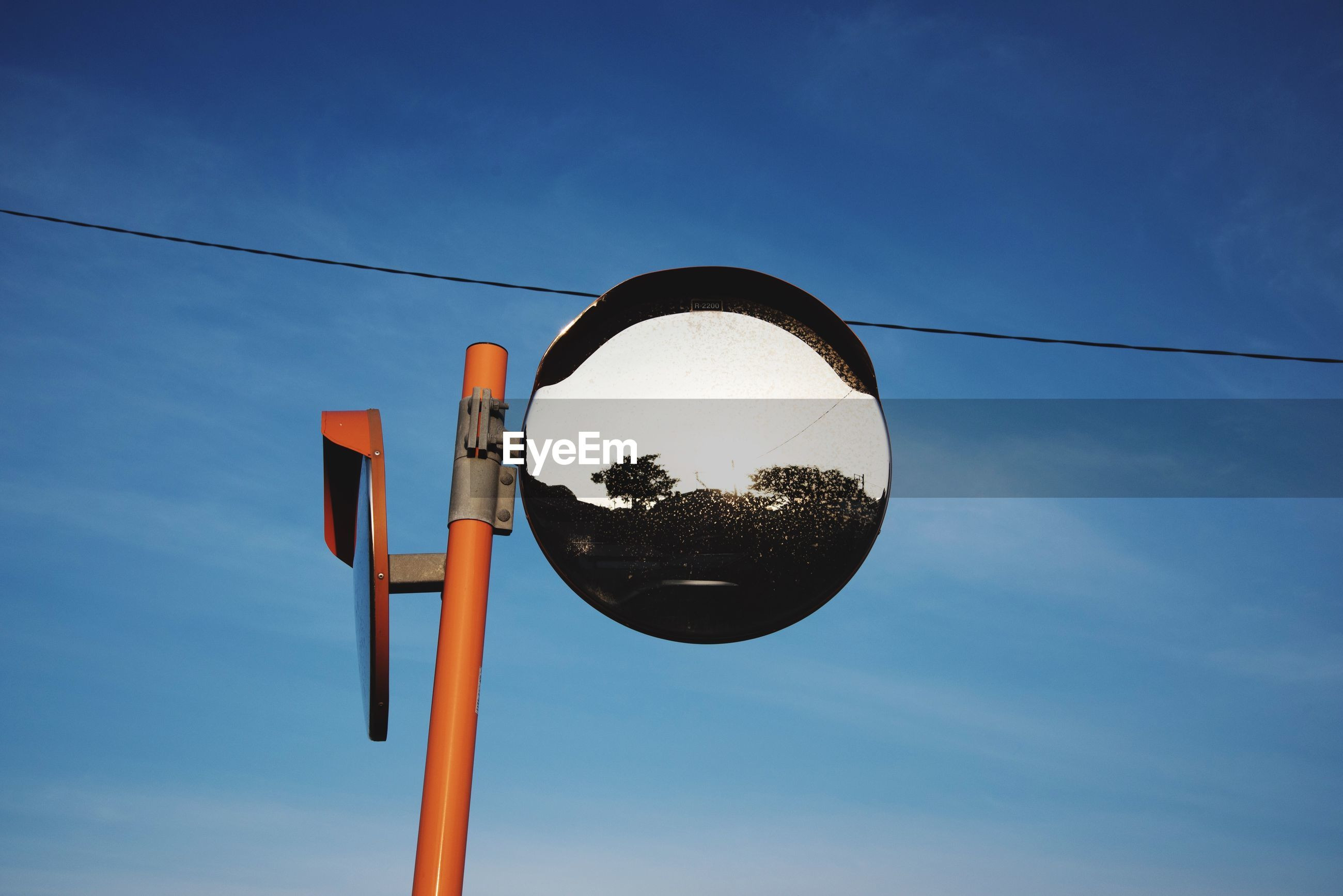 low angle view, sky, blue, hanging, street light, lighting equipment, cloud, tree, cloud - sky, pole, outdoors, no people, electricity, day, cable, silhouette, basketball hoop, clear sky, nature, circle