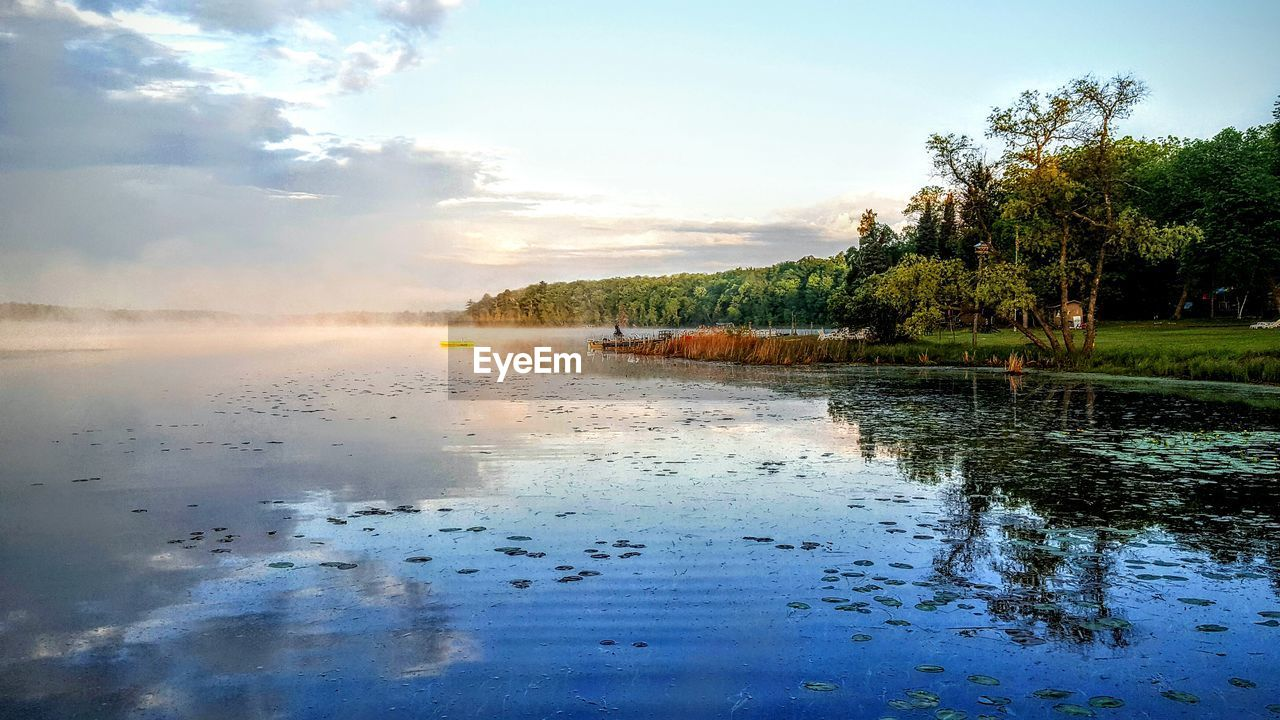 water, scenics, beauty in nature, nature, sky, tree, tranquil scene, tranquility, cloud - sky, outdoors, no people, day, reflection, lake, steam, hot spring