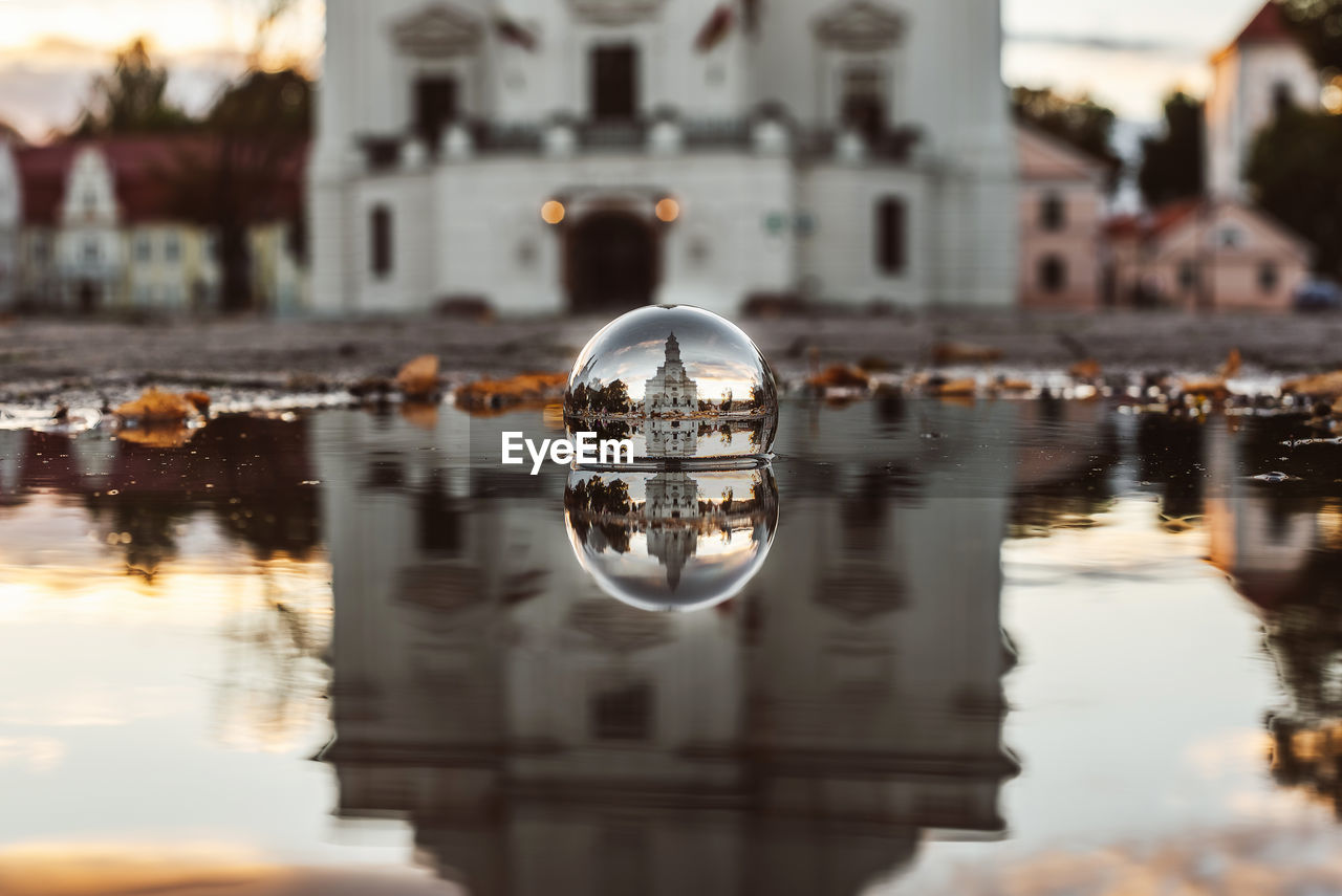 Reflection Of Church On Crystal Ball In Puddle