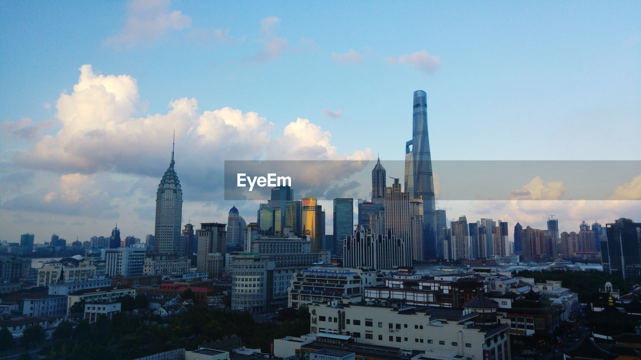 Modern Skyscrapers In City Against Sky