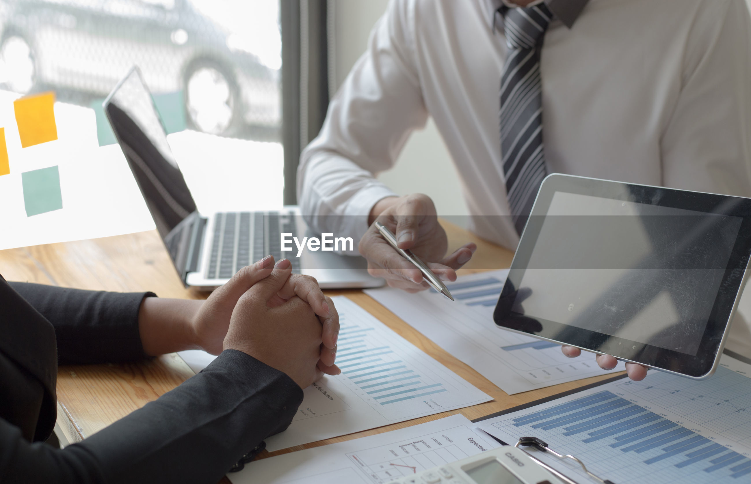 Cropped image of business colleagues working in office