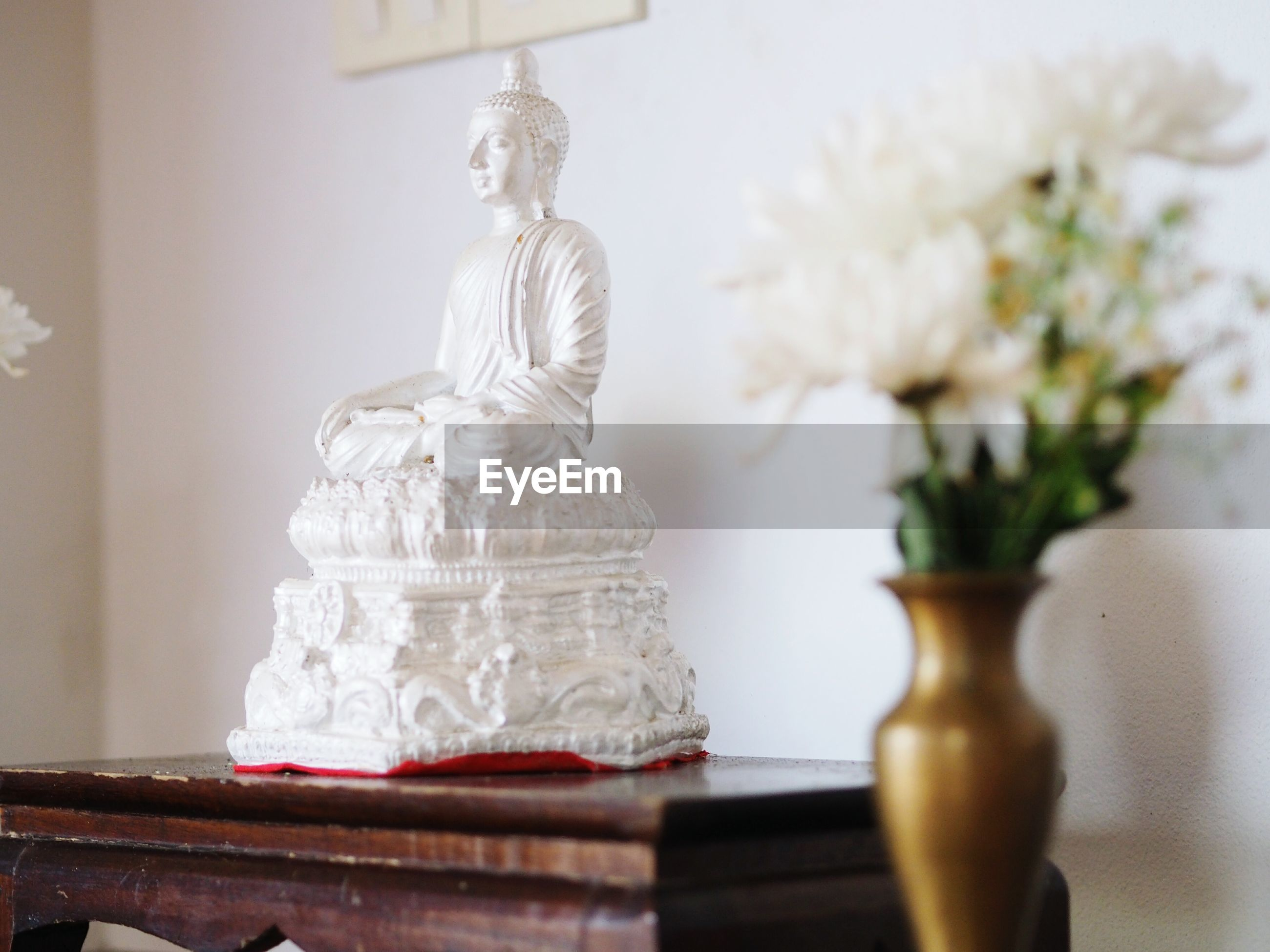 indoors, table, no people, statue, close-up, day