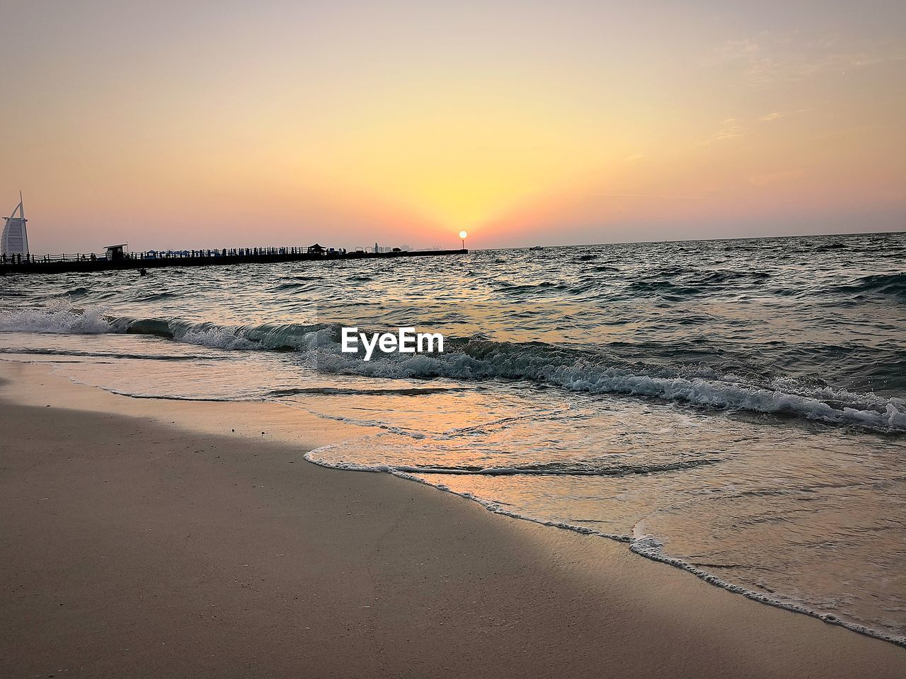 sunset, sea, beach, water, beauty in nature, scenics, nature, tranquil scene, tranquility, sand, horizon over water, shore, orange color, sky, sun, wave, idyllic, outdoors, no people, travel destinations, vacations, clear sky, day