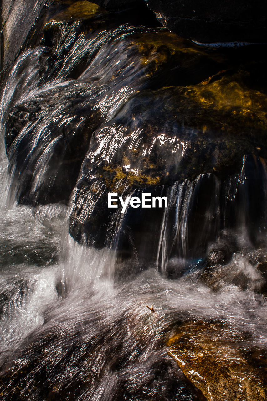 waterfall, rock - object, no people, power in nature, beauty in nature, scenics, nature, water, sea, outdoors, day