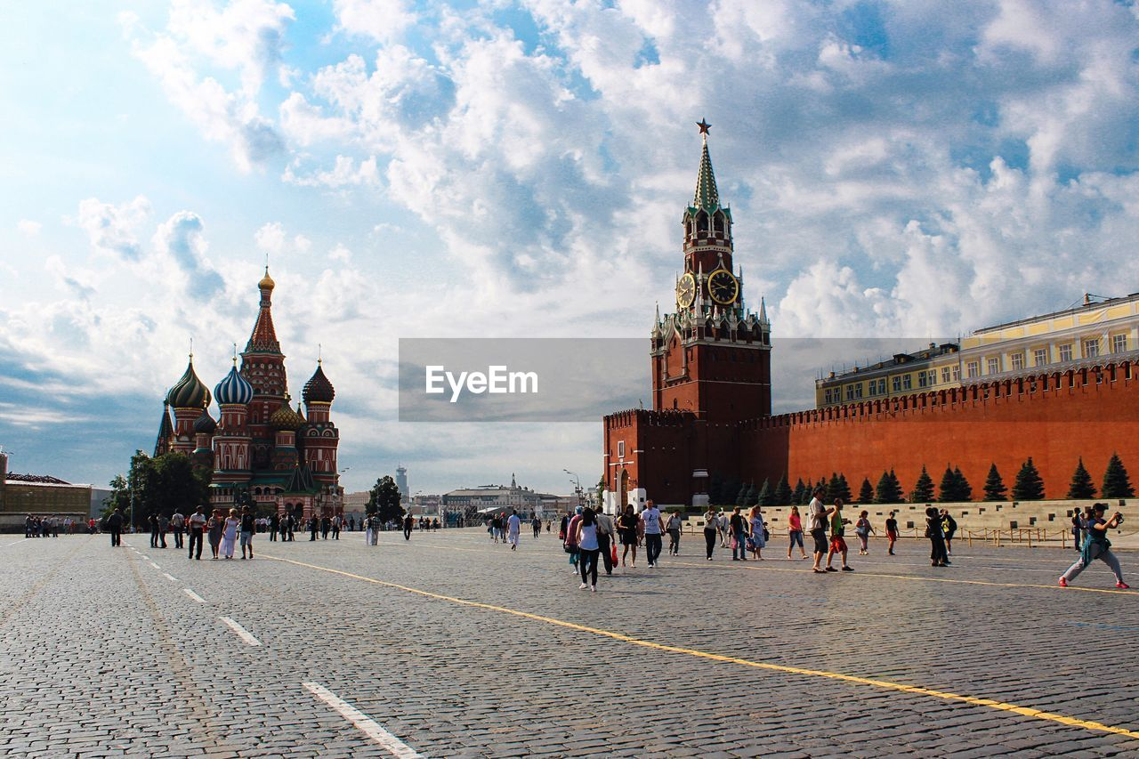 People walking in front of against sky st. basil cathedral