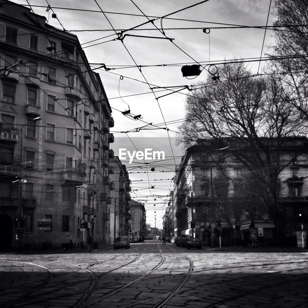 Tram tracks on street along buildings