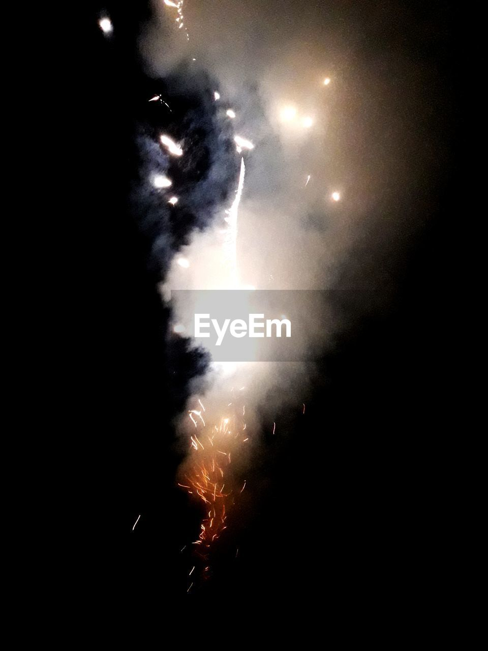 night, event, firework display, exploding, arts culture and entertainment, firework - man made object, smoke - physical structure, low angle view, celebration, illuminated, outdoors, sky, no people, long exposure, firework, burning, motion, nature, close-up