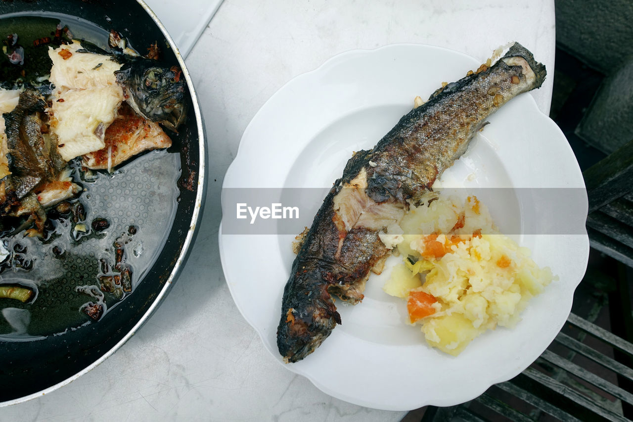 High angle view of fried fish with mashed potatoes in plate