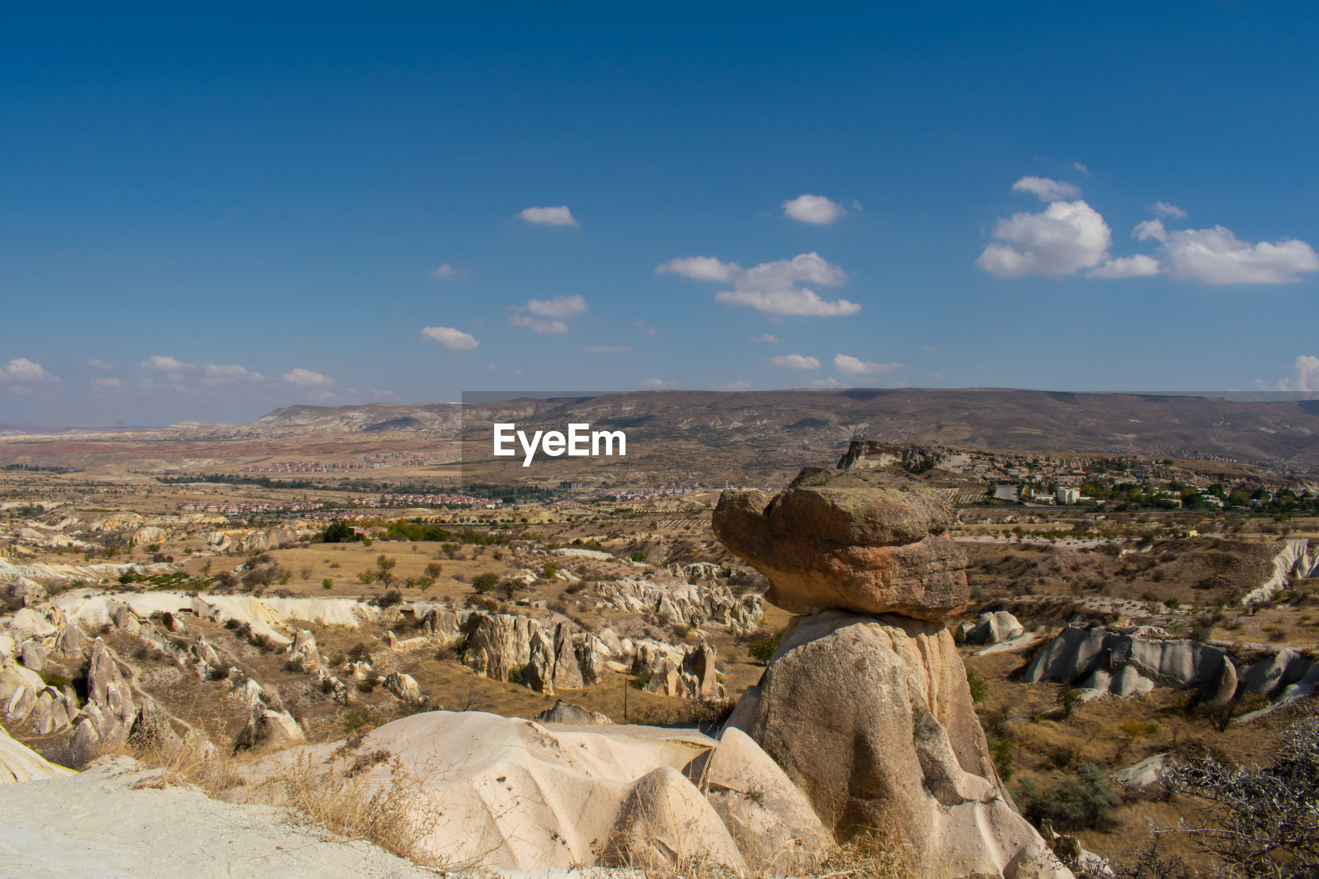 SCENIC VIEW OF ROCKS ON LANDSCAPE AGAINST SKY