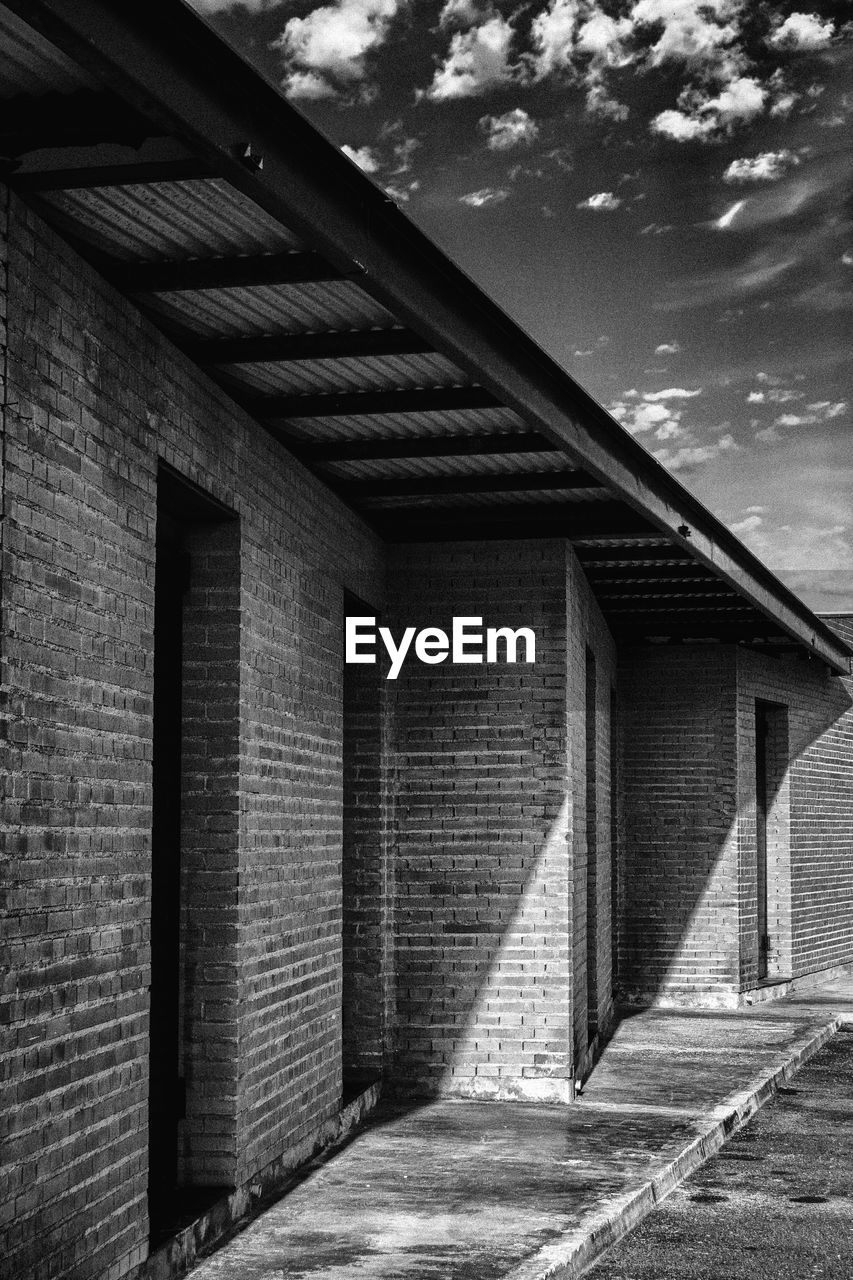 architecture, built structure, building exterior, brick wall, day, outdoors, no people, sky