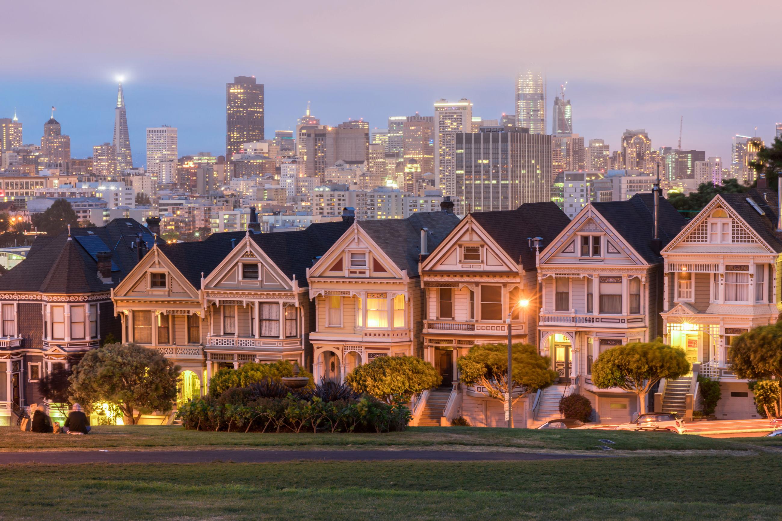 Illuminated buildings in city at dusk