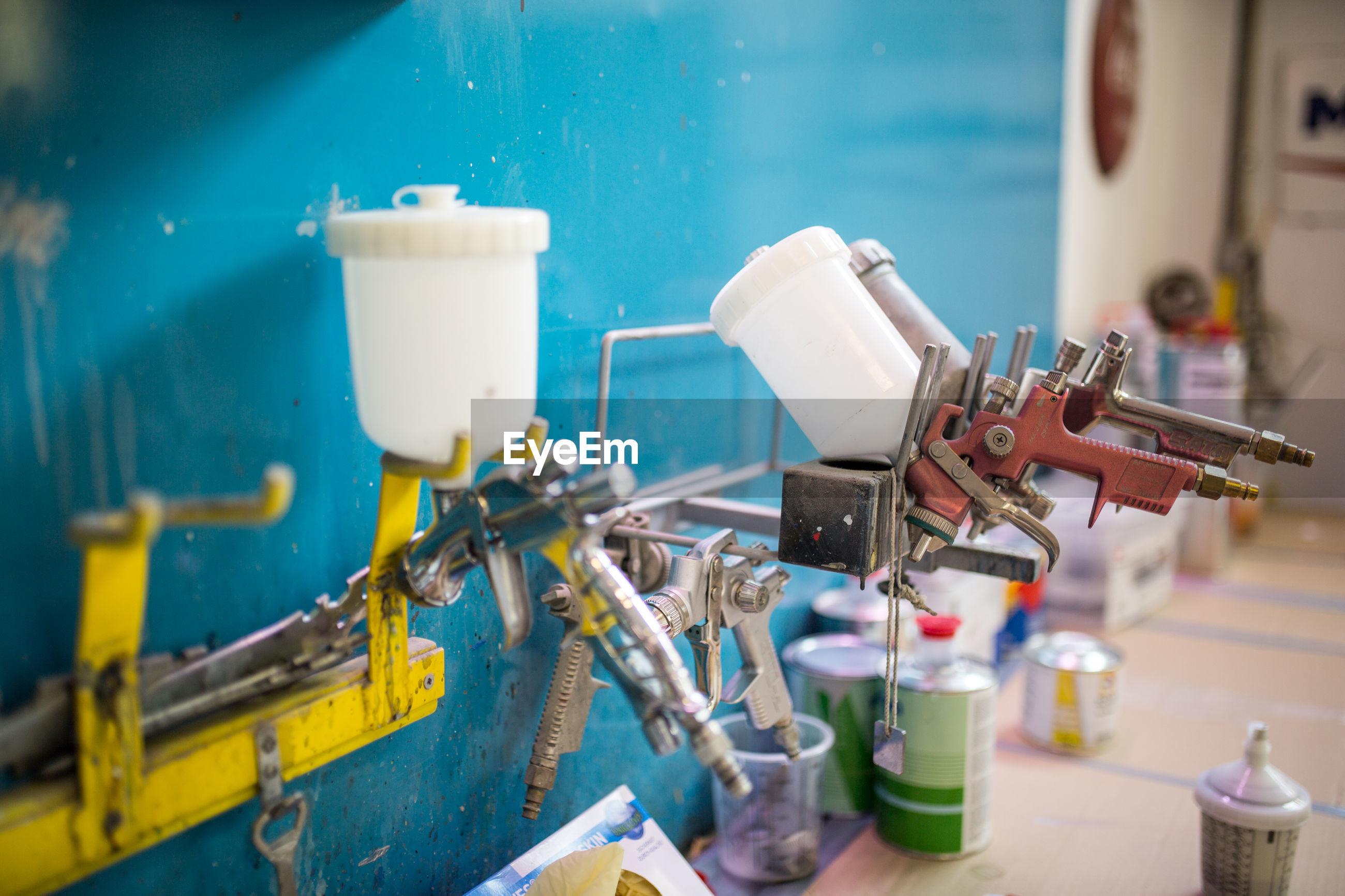 Paint spray guns at workshop