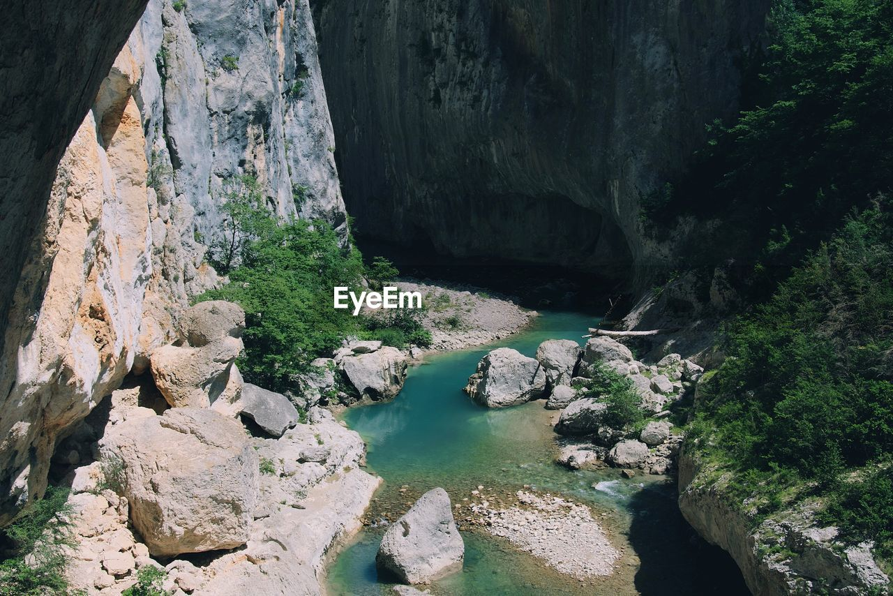 water, rock, rock - object, solid, rock formation, beauty in nature, tranquility, scenics - nature, nature, day, tranquil scene, no people, non-urban scene, high angle view, river, geology, physical geography, land, plant, outdoors, flowing, eroded, formation, flowing water