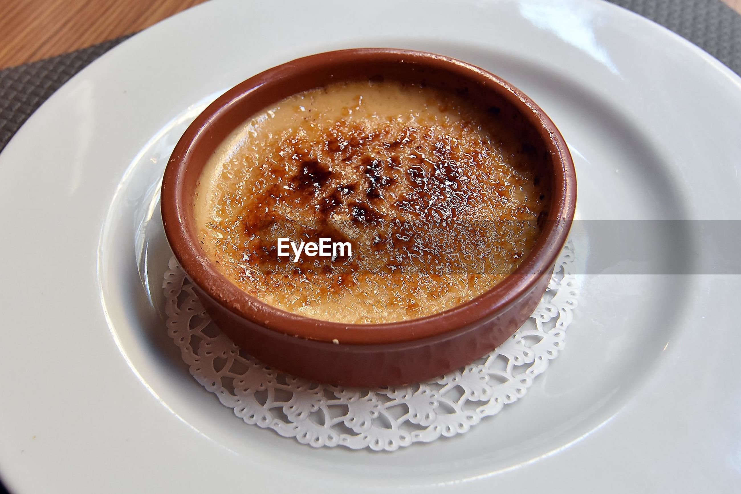 High angle view of creme brulee served in bowl on plate