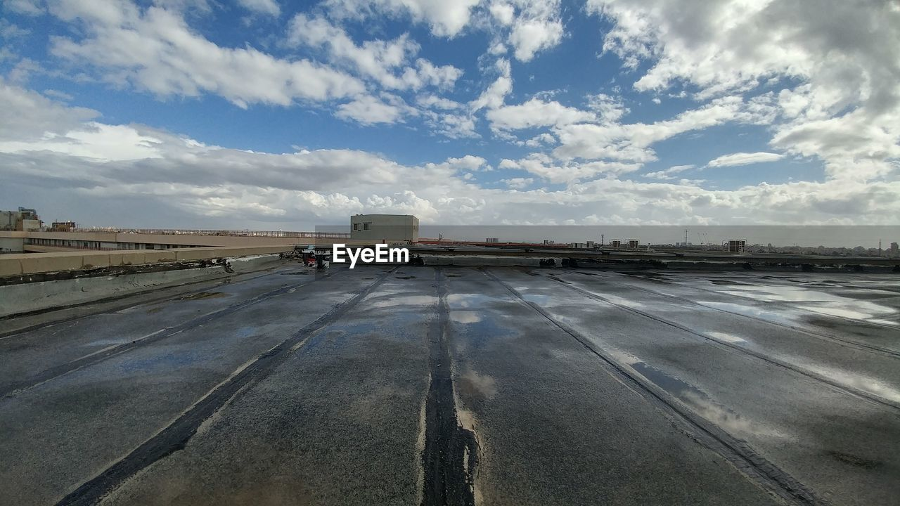 transportation, cloud - sky, sky, mode of transport, airport, day, land vehicle, airport runway, outdoors, airplane, no people
