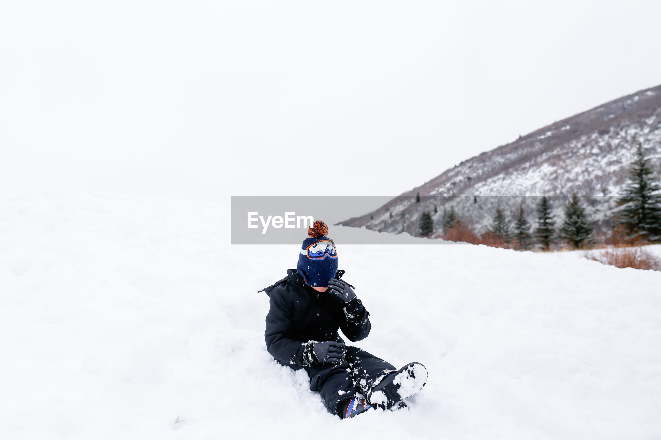 MAN ON SNOW COVERED FIELD DURING WINTER