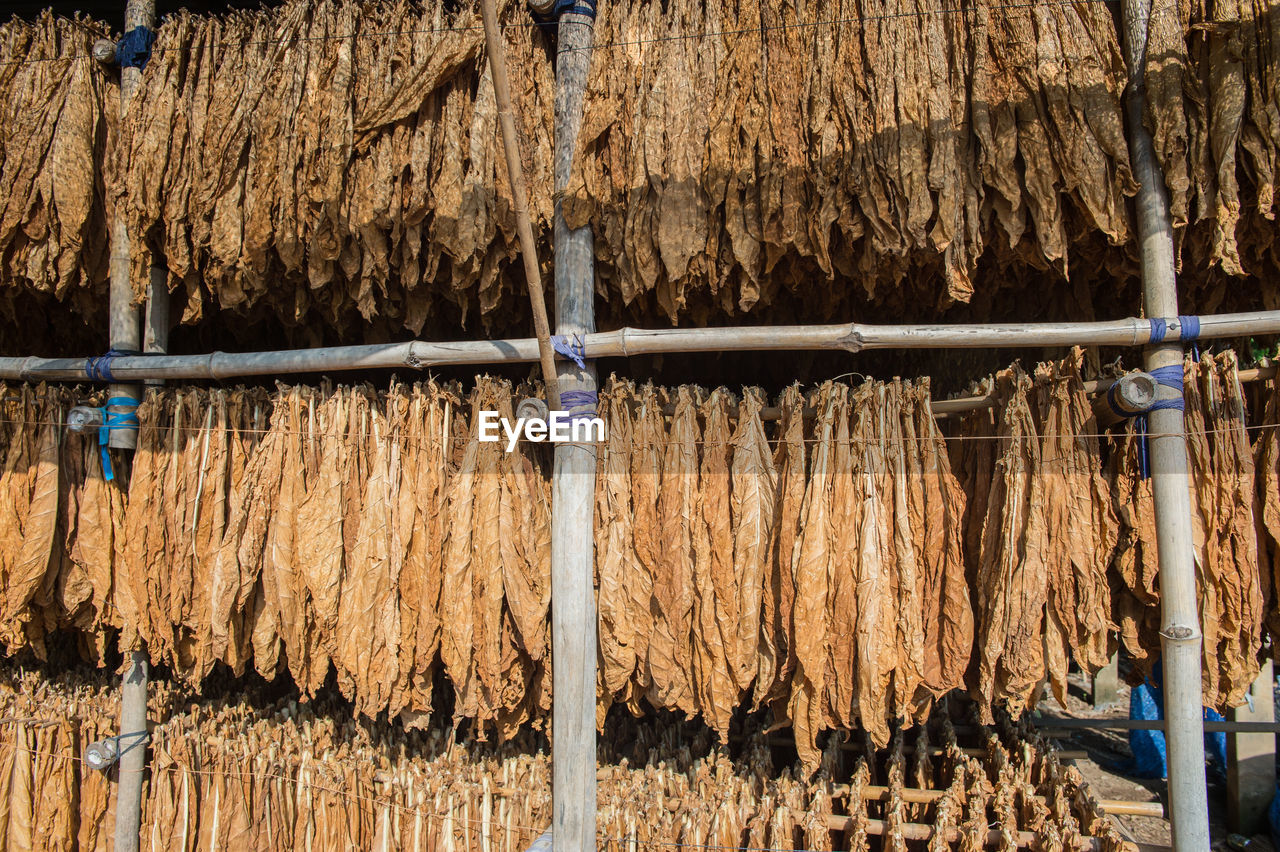 CLOTHES DRYING ON WOODEN POST AGAINST BUILDING