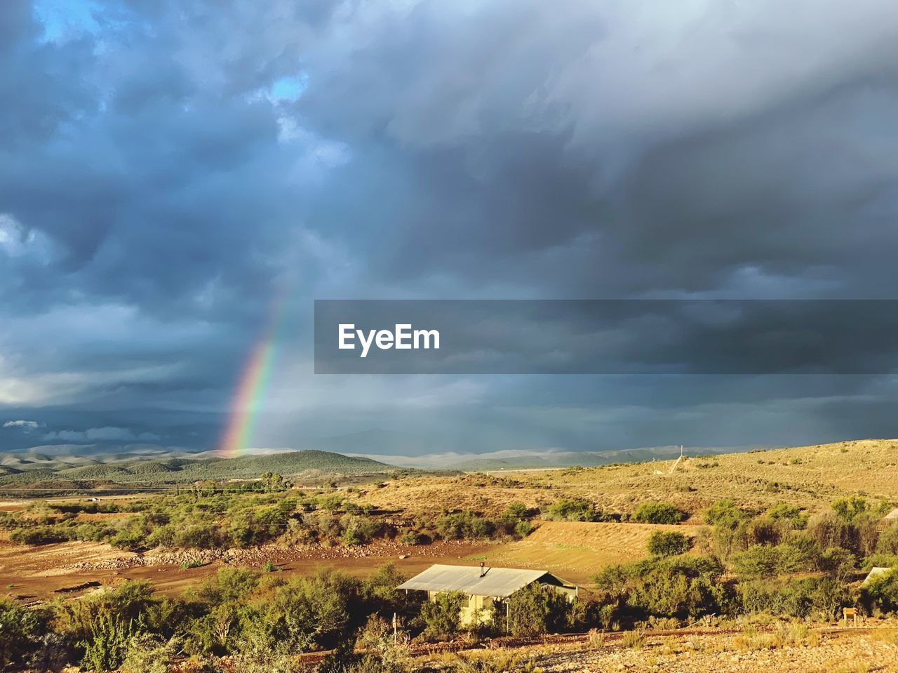 cloud - sky, rainbow, beauty in nature, sky, environment, scenics - nature, landscape, tranquil scene, tranquility, no people, land, nature, overcast, non-urban scene, day, plant, field, idyllic, rural scene, double rainbow, outdoors