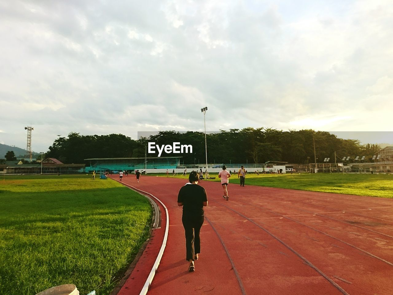 sport, cloud - sky, sky, real people, men, playing field, day, tree, lifestyles, grass, full length, exercising, competition, healthy lifestyle, one person, outdoors, playing, running track, sports track, sportsman, sports clothing, competitive sport, nature, city, people, adult, adults only