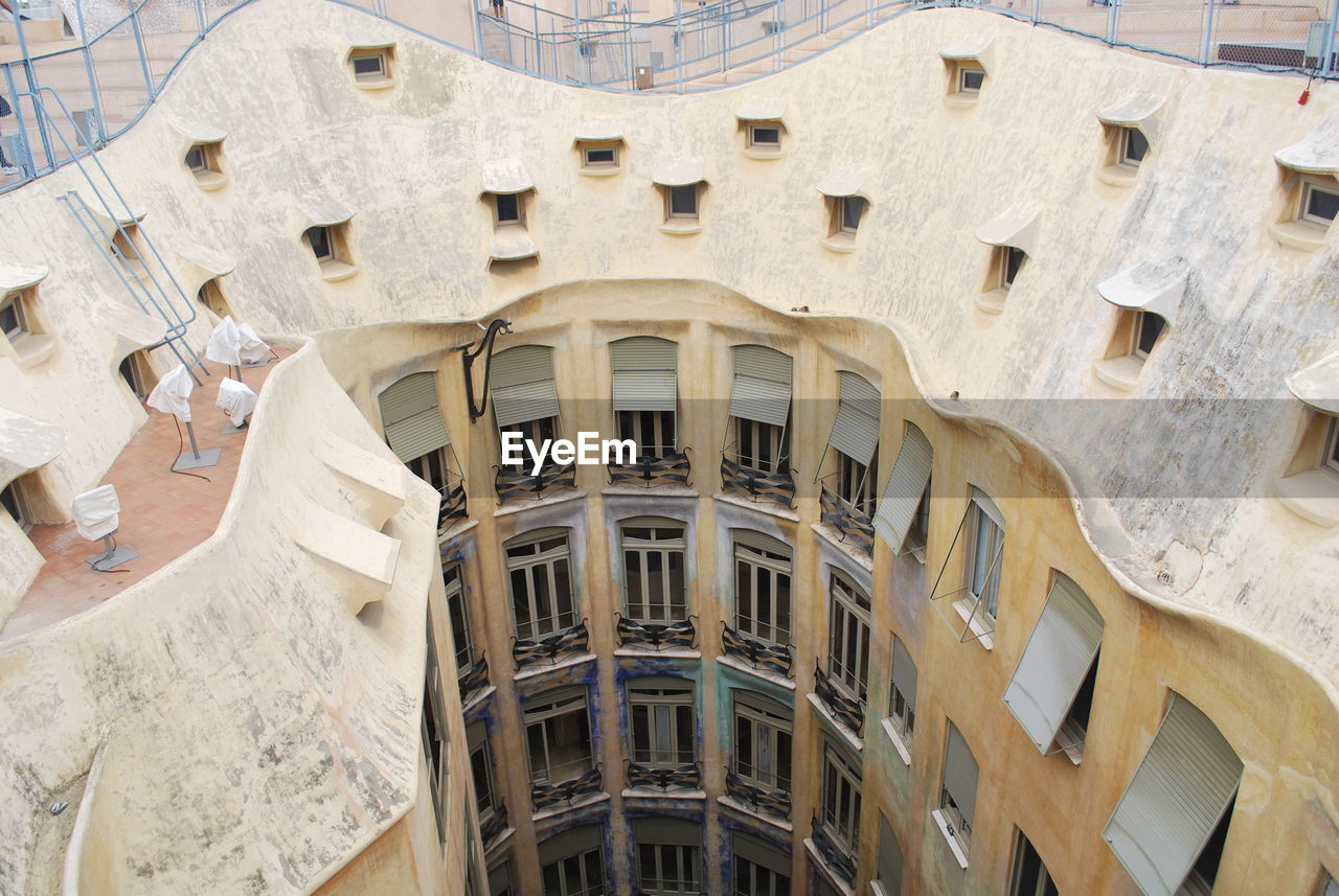 architecture, built structure, building exterior, low angle view, balcony, window, no people, day, outdoors, close-up