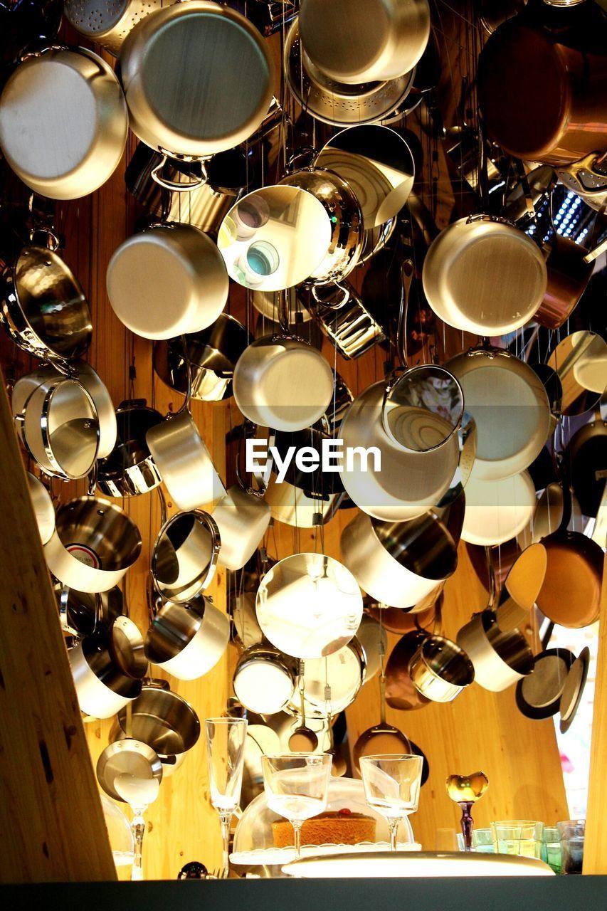 no people, indoors, abundance, hanging, large group of objects, illuminated, backgrounds, retail, full frame, night, close-up