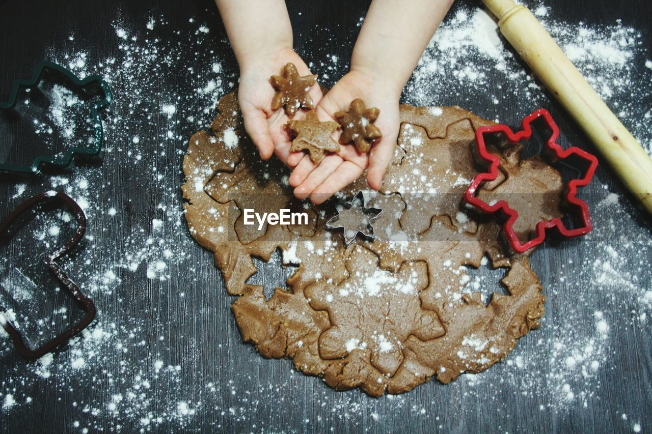 Cropped Image Of Child Holding Star Shape Cookies