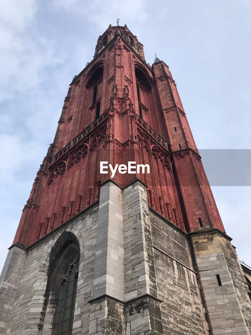 architecture, low angle view, sky, built structure, building exterior, religion, belief, history, the past, tower, spirituality, building, place of worship, nature, tall - high, no people, day, cloud - sky, gothic style