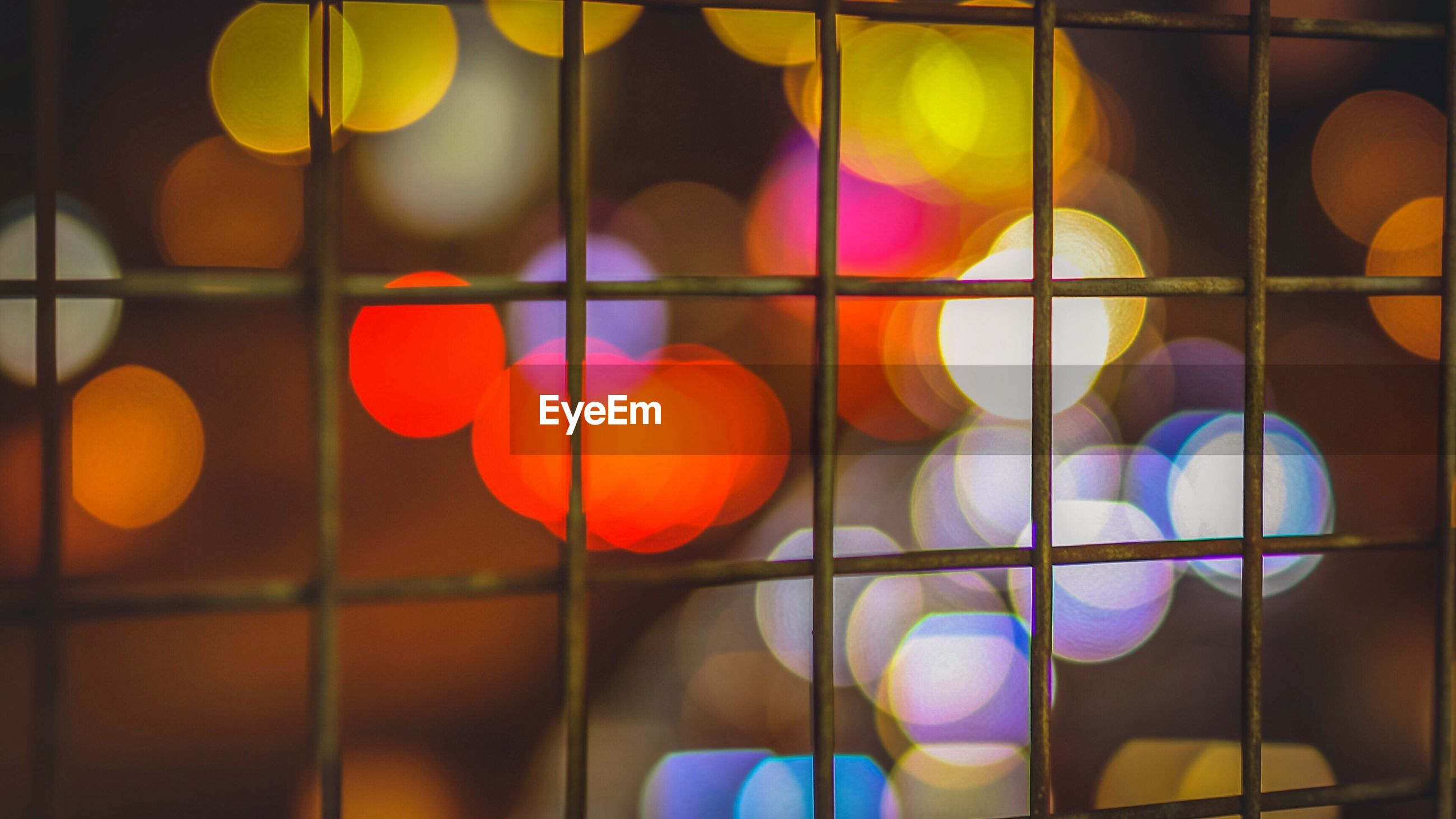 illuminated, lighting equipment, circle, close-up, pattern, glowing, multi colored, colorful, lens flare, focus on foreground, fairy lights, geometric shape, outdoors, no people, window frame, spotlight, electric light, yellow color