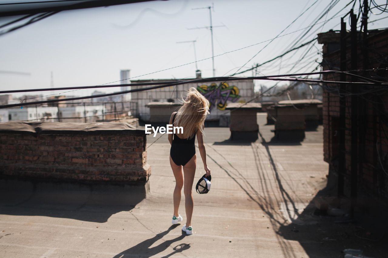 Bikini woman walking outdoors