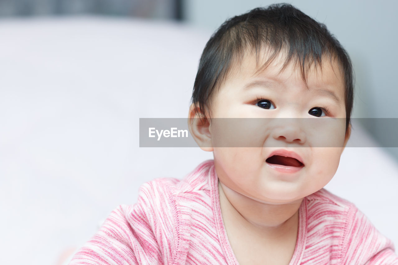 Cute Baby Girl Crying While Looking Away