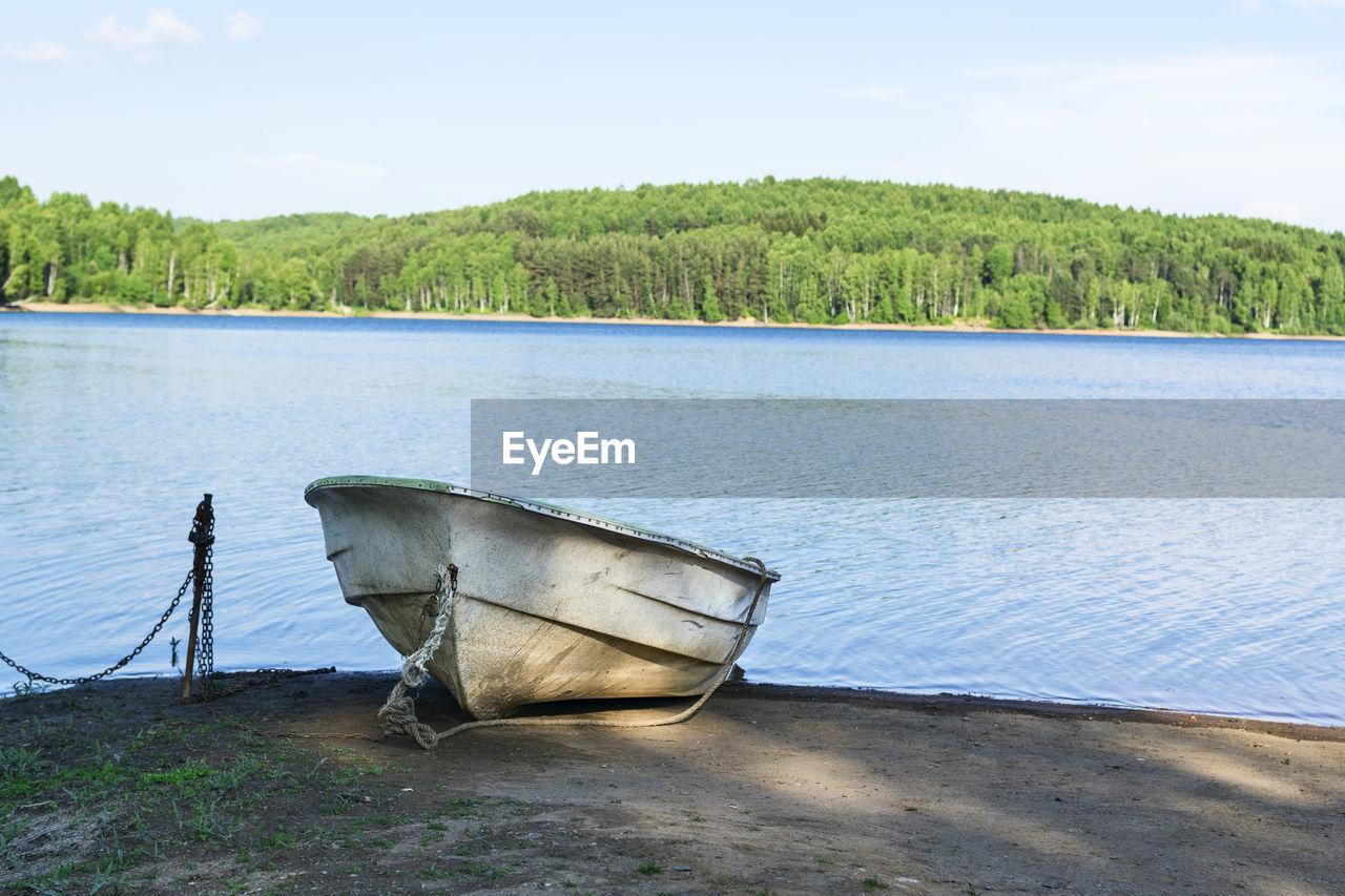 Boat In Lake Against Sky