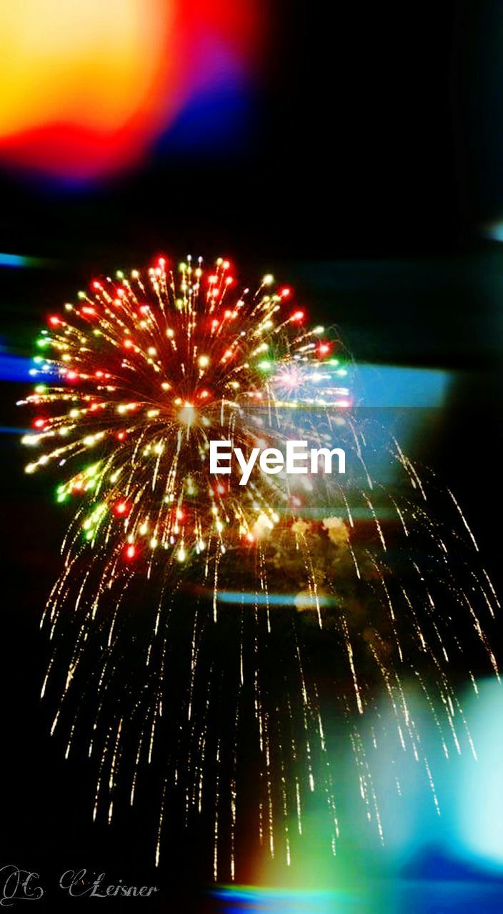 night, firework display, firework - man made object, celebration, exploding, long exposure, arts culture and entertainment, low angle view, illuminated, no people, multi colored, blurred motion, motion, outdoors, sky, close-up
