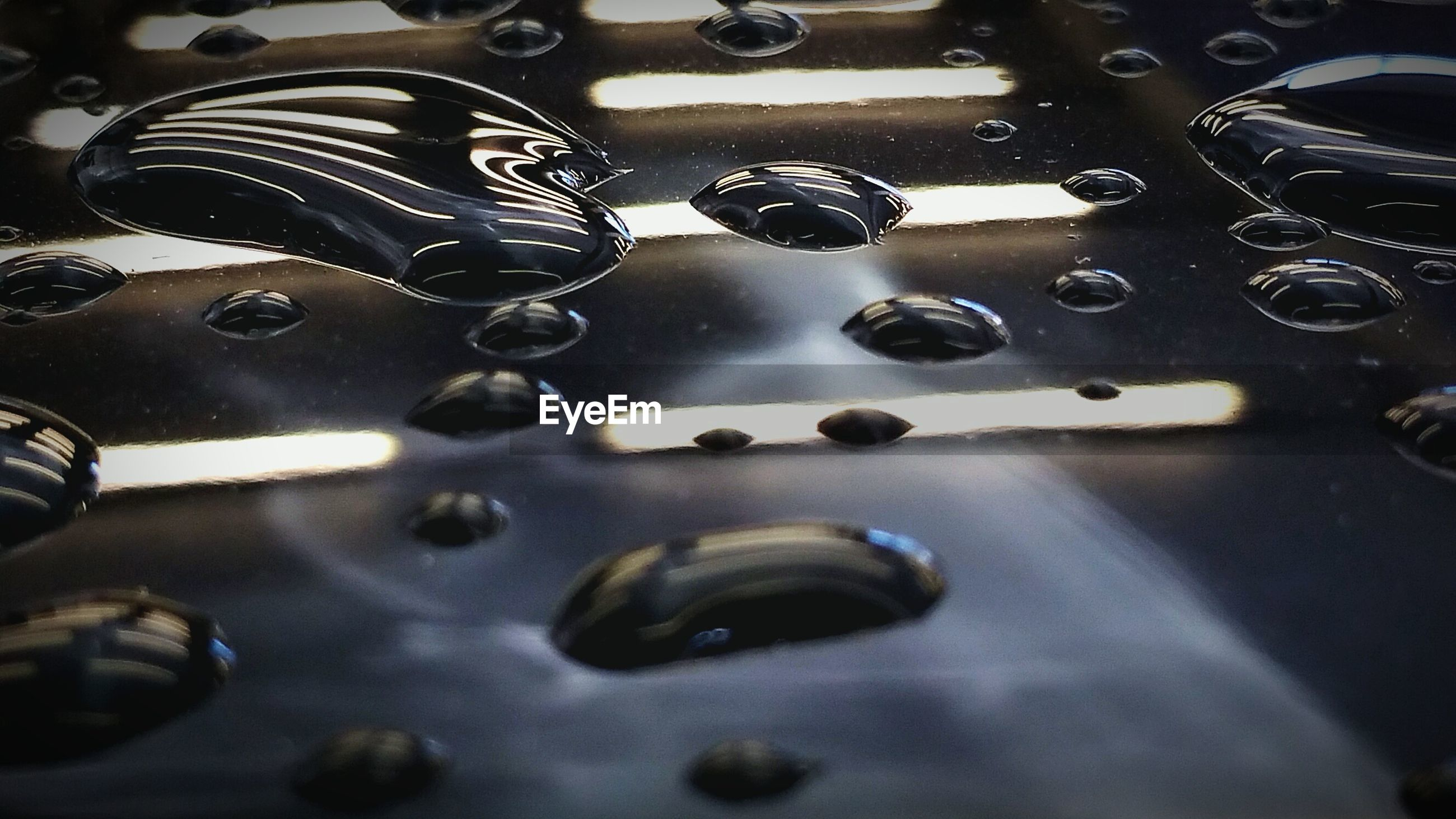 High angle view of water drops on floor