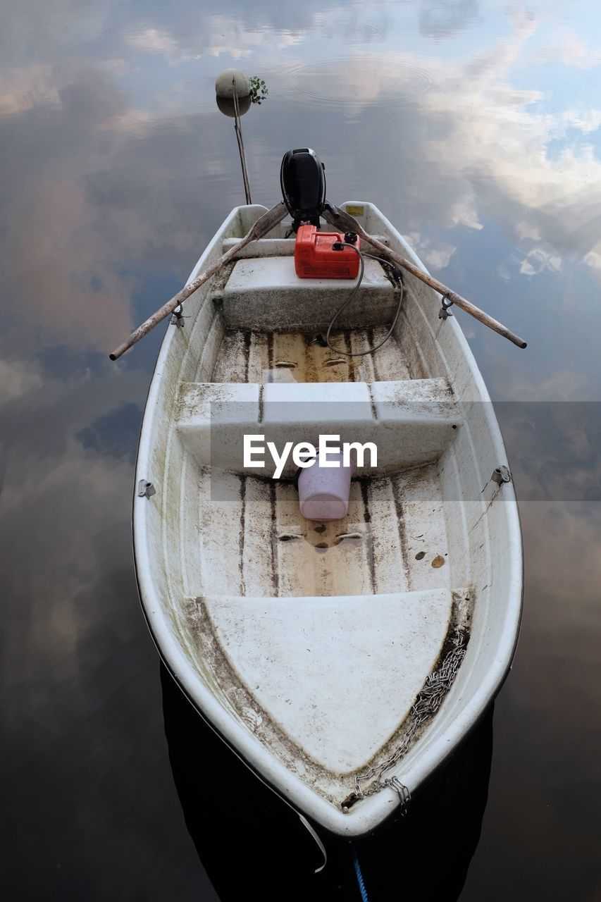 nautical vessel, transportation, cloud - sky, mode of transportation, water, sky, nature, day, moored, no people, outdoors, focus on foreground, sea, high angle view, hanging, wood - material, buoy, reflection