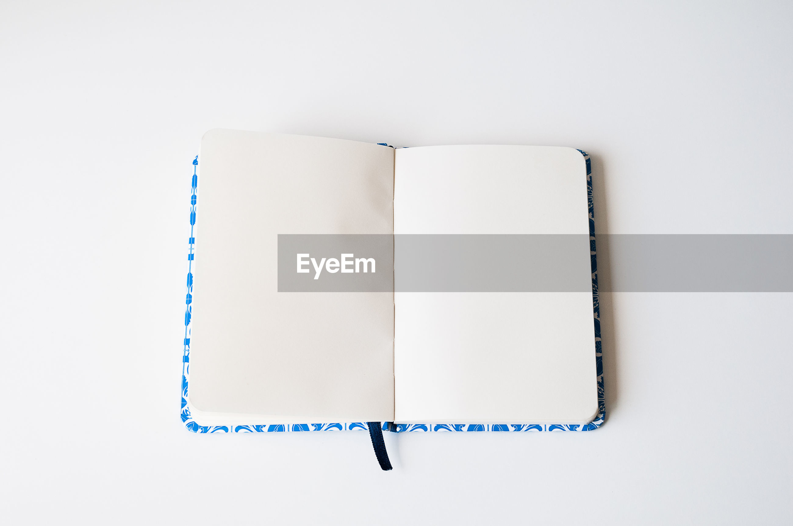 High angle view of open book on white background